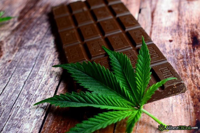 Best CBD chocolate: a chocolate bar and a hemp leaf on it.