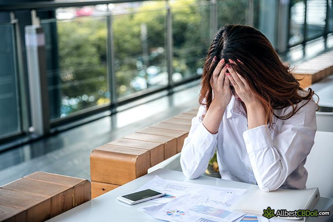 Best CBD oil for anxiety: a woman suffering from a lot of stress.
