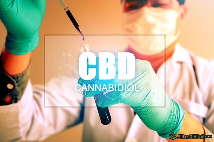 Best CBD oil for cancer: CBD sign and a scientist in the background.