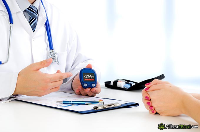 Best CBD oil for diabetes: a doctor holding a diabetes test machine.