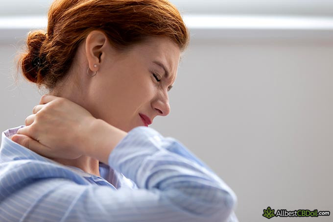 Best CBD oil for fibromyalgia: a woman with neck pain.