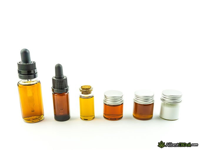 Hemp Oil vs CBD Oil: different kinds of bottles with different color oil