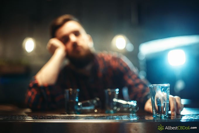 cbd and alcohol: a man drunk at the bar