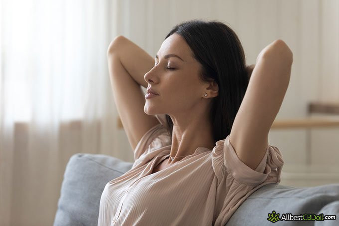 What does CBD feel like: woman relaxing on the sofa